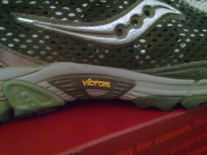 Saucony ProGrid Xodus Trail Running Shoe with Vibram Outsole closeup logo.