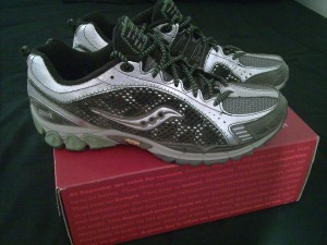 Saucony ProGrid Xodus Trail Running Shoe with Vibram Outsole on top of shoe box.