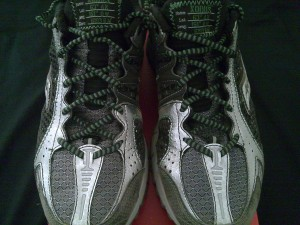 Saucony ProGrid Xodus Trail Running Shoe with Vibram Outsole lined up.