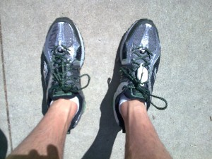 Saucony ProGrid Xodus Trail Running Shoe with Vibram Outsole action shot.
